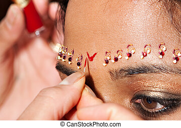 Red Bindi - A Red Bindi is applied to a Hindu brides...