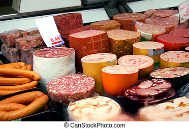 a variety of german sausage products in cooling shelf