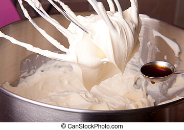adding vanilla extract to cream - adding vanilla extract to...