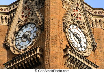 Twin clock tower - A closeup of a twin clock tower in a city...