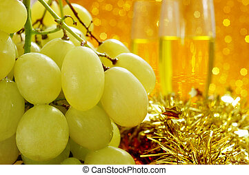 grapes and champagne - closeup of a bunch of grapes and...