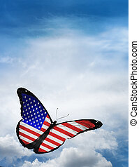 USA flag butterfly flying on sky background