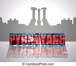 View of Pyongyang - Word Pyongyang with national flag of...
