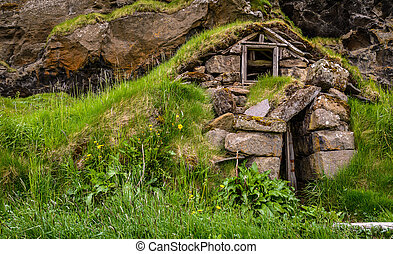 Ruins of a traditional Icelandic turf house (with grass...