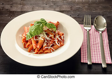 Plate of penne pasta with arrabiata sauce, a hot spicy sauce...