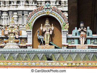 Lord Murugan Statue on glorious covered walkway to...