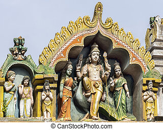 Lord Murugan and his two wives on top of his shrine at...
