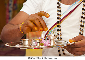 INdian Priest - A Hindu priest prepares for a pre-wedding...