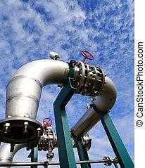 industrial pipelines on pipe-bridge against blue sky - boil,...