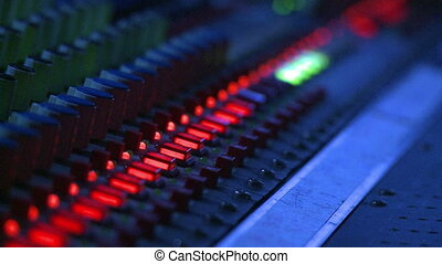 Mixing Board Controls - Floating close up on the controls of...