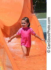 Child play with water in water park - Child (girl age 04)...