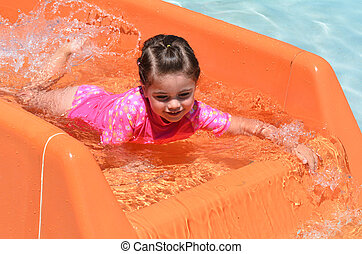 Child play with water in water park - Child girl age 04 play...