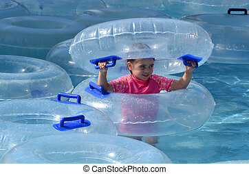 Child play with Inflatable clear inner tubes - Child Girl...