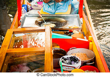 Mexican vendor of food on Xochimilco gondola trajinera