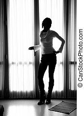 Girl Silhouette - Silhouette of a girl in front of a window