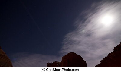 Moon and Stars Tracking Time-lapse - The Moon and clouds...