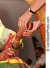 Bridal Ceremony - A young indian bride takes part in a...