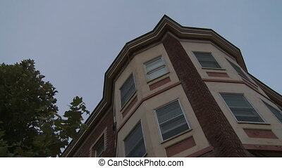 Apartment, Low Angle with Trees - Low angle looking up at a...