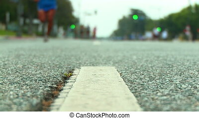 Marathon Runners from Ground Level - Slow motion low angle...