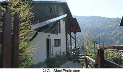New modern mountain cabin - Steadycam shot of a new modern...