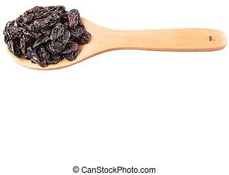 Black Raisin - Black raisin in a wooden box over white...