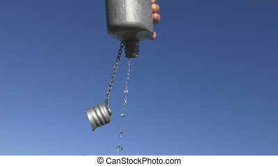 Flask, last drop of water - Isolated shot of hand holding...