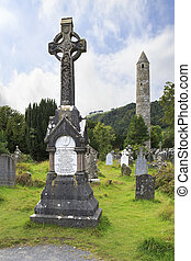 Celtic cemetery and a round tower - Medieval Celtic cemetery...