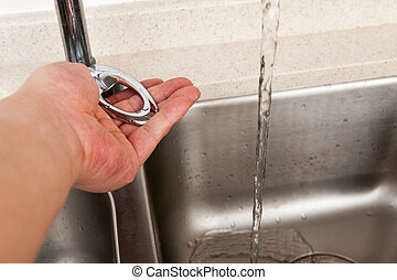 Turning on water tap