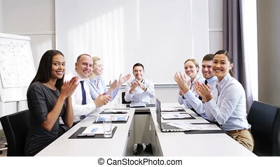 smiling business people meeting in office - business,...