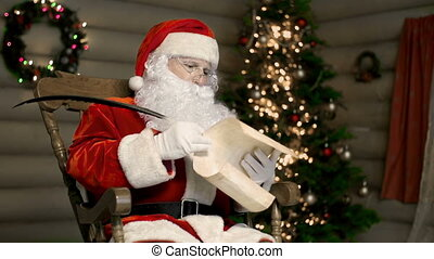Dear Santa - Santa sitting in rocking chair with bothered...