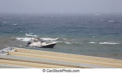 Boat on a leash in stormy Aegean Sea. Sithonia peninsula....