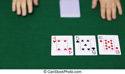 holdem poker dealer with playing cards - casino, gambling,...