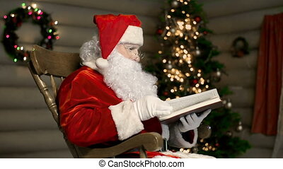 Christmas Eve Reading - Santa Claus reading to himself in a...