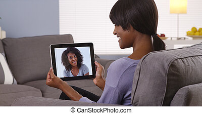Cute black girlfriends talking talking together via internet