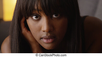 Sultry African woman looking at camera