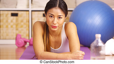 Tough Japanese woman resting after workout