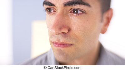 Closeup of sad Mexican man