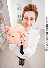 wide angle of a clerk with a piggy bank