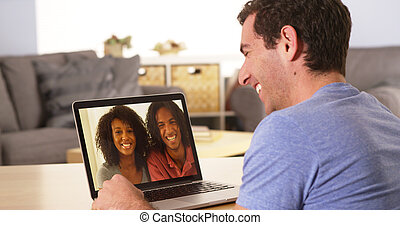 Diverse friends videochatting on laptop