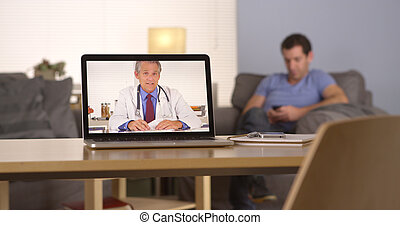 Doctor giving advice via webcam