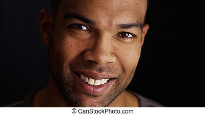 Smiling black man looking at camera