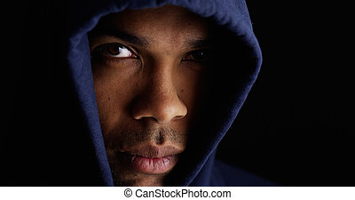 Black man wearing blue sweater