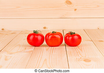 Fresh cherry tomatoes in a row.