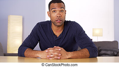 Black man talking to camera