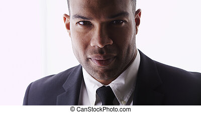 Attractive black man looking at camera wearing suit