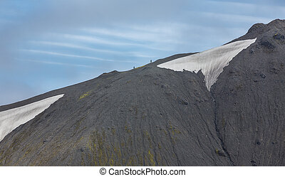 Tourists along the ridge in Landmannalaugar lava landscape -...