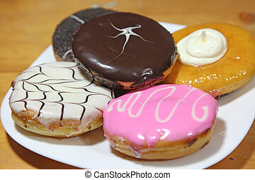 Assorted donuts varieties cream and chocolate