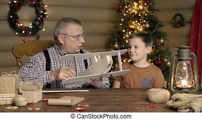 Do It Yourself - Boy playing with plane dummy created by...