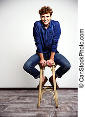 Smiling man sitting on the chair