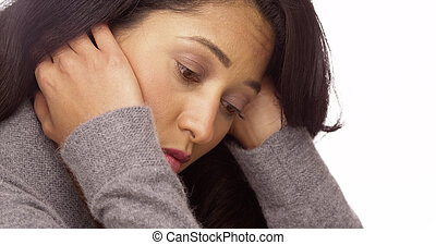Mexican woman overwhelmed with stress
